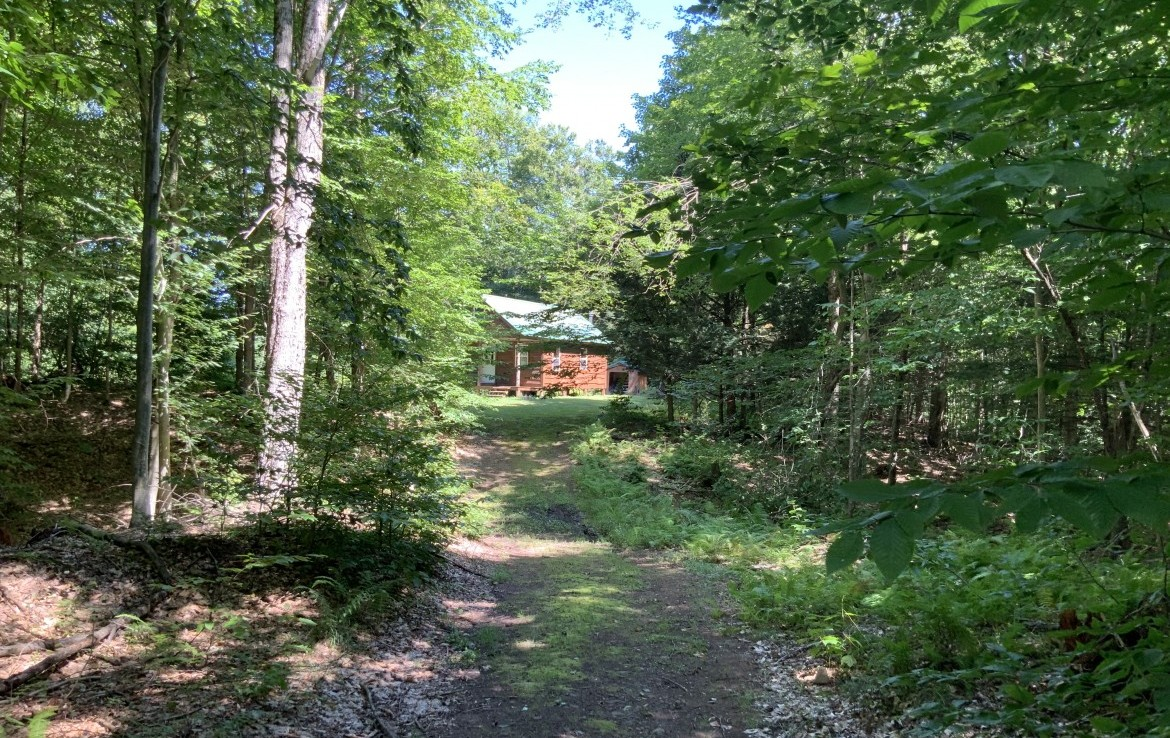 23 acres Hunting Land and Cabin for sale with waterfront acreage in Amboy, NY!