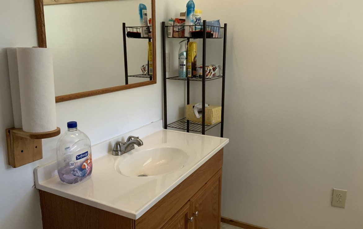 Full bathroom with shower, sink and toilet.