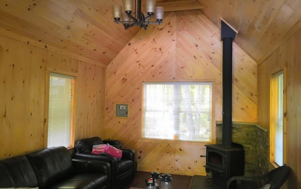 it has laminate flooring and there is had crafted stonework around the woodstove