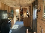 kitchen with electric stove/oven, refrigerator, and cabinets.